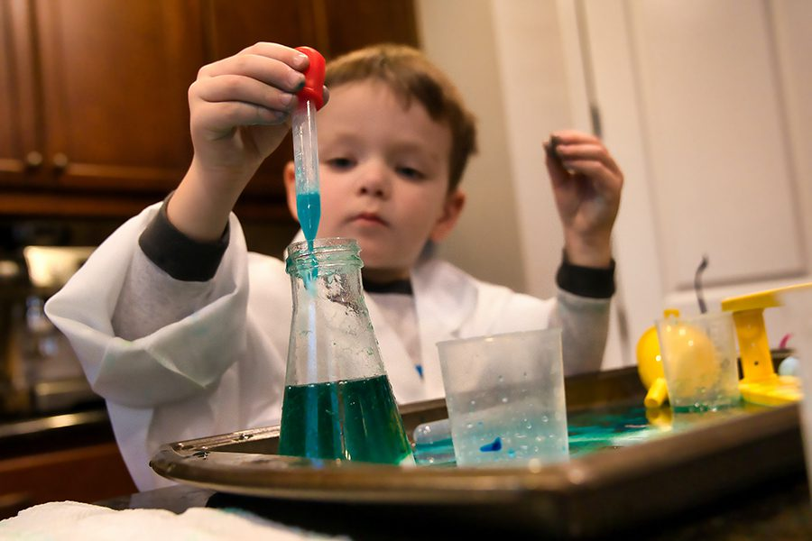 Child with a science experiment kit